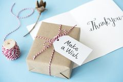Brown Gift Box Beside Thread royalty free stock photo