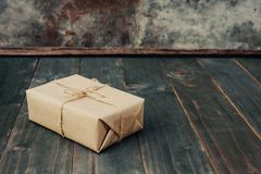 Brown gift box on wooden table background with copy space royalty free stock photography