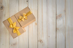Brown gift boxes with gold bow Stock Images