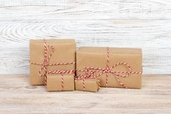 Brown gift boxes on grey wooden table.  Royalty Free Stock Image