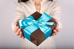Brown gift white shirt woman Stock Image