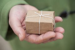 Brown gift in woman hand - valentines day concept Stock Image