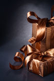 Brown giftboxes on black background with copyspace Stock Photo