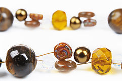 Brown glass beads. With shell on a white background Royalty Free Stock Image