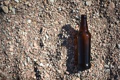 Brown Glass Bottle Floating in Water Stock Images