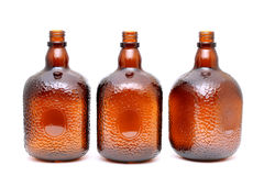 Brown glass bottle on white. Brown glass bottle on a white background Stock Photography