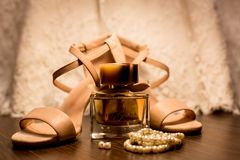 Brown Glass Fragrance Bottle Beside White Pearl Bracelets Stock Photo