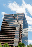 Brown Glass Office Tower Under Nice Skies. A Brown Glass Office Tower Under Nice Skies Royalty Free Stock Images