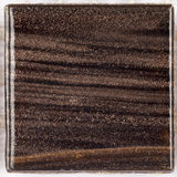 Brown glass smalt with stripes aventurine Royalty Free Stock Images