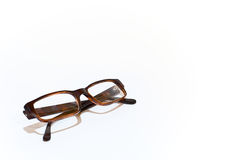 Brown glasses. On the white background Royalty Free Stock Photos