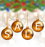 Brown glossy balls with lettering sale, Christmas decoration Stock Photography