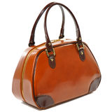 Brown glossy female leather bag. Isolated on white background Stock Photos