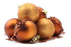Brown and gold Christmas ornaments Stock Photography