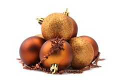 Brown and gold Christmas ornaments Stock Photos