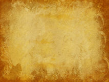 Brown and Gold Distressed Paper Texture Background with Dark Edges. Suitable for print or web use Stock Photography