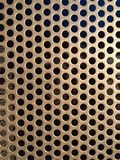 Brown/gold metal grate texture with holes close. This blue grate is part of a bike locker. I thought it had great texture Stock Images