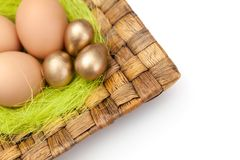 Brown and golden easter eggs are on wattled plate Stock Photography