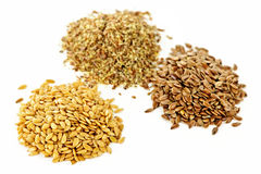 Brown, golden and ground flax seed royalty free stock image