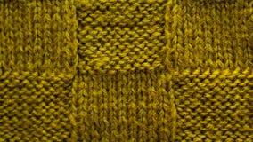 Brown-grüner Hintergrund des gestrickten Garns, Beschaffenheitsmustermaschenware stockfotografie