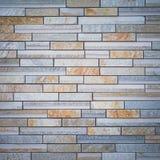 Brown granite stone block wall Stock Photo