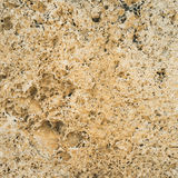 Brown granite texture. Natural rough untreated and unpolished stone wall with grain surface. Stock Photo