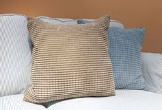 Brown and Gray Decorative Pillow on Comfortable Sofa. Modern Cozy Sofa with Brown and Gray Decorative Square Pillow or Cushion, Close Up royalty free stock images