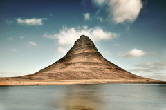 Brown and Gray Mountain Near a Body of Water Royalty Free Stock Photo