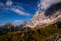 Brown and Gray Mountain Under Blue and White Sky Stock Photography