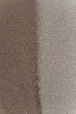 Brown Gray Sands Join. A close up view of the fine grains of brown and gray sands with a joining or merging line on a hillside bank. The vertical framed photo Royalty Free Stock Photography