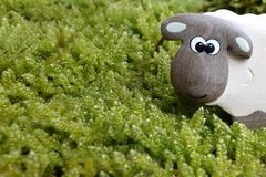 Brown and Gray Sheep to on Green Grass Field Toy Royalty Free Stock Images