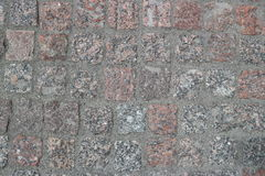 Brown and gray square stones paved road Stock Image
