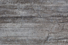 Brown-gray stone. Texture of a brown-gray stone with cracks closeup Stock Photography