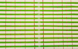 Brown and green bamboo mat Royalty Free Stock Photography