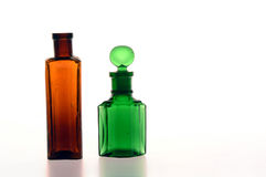 Brown and Green Bottle. Victorian green and brown bottles on a white background stock photo