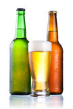 Brown and green bottles full of condensate Royalty Free Stock Photo