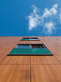 Brown and green facade. Of a building in the Netherlands Stock Images