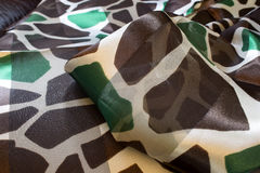 Brown and Green Giraffe print polyester scarf Stock Photos