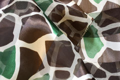 Brown and Green Giraffe print polyester scarf Stock Images