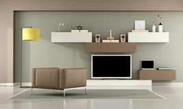 Brown and green living room with television set Stock Images