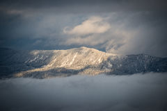 Brown and Green Mountain Under White Clouds Royalty Free Stock Photo