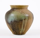 Brown & Green Stoneware Pot. Hand thrown pot with speckled glaze Royalty Free Stock Photos