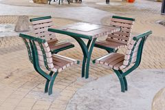 Brown and Green table and chairs in park.- rest area. Royalty Free Stock Photo