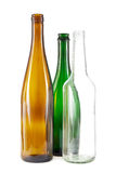 Brown, green and white glass bottles. Group of brown, green and clear white glass bottles on white Royalty Free Stock Photography