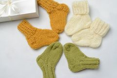 Three pairs of handmade newborn socks, ready to be given as a gift stock images