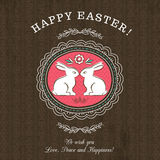 Brown greetings card for Easter Day with two rabbits Royalty Free Stock Photos
