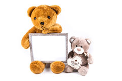 Brown and grey fuzzy teddy bears with a grey frame Stock Photo