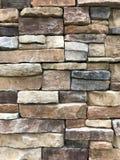 Brown and grey granite stone wall stock photo