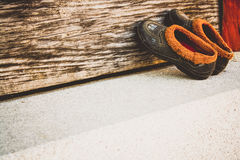 Brown and Grey Shoes on Brown Wooden Plank during Daytime Royalty Free Stock Images
