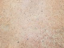 Brown and grey surface with rocks in it royalty free stock photo