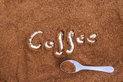 Brown ground coffee whit spoon Stock Photos